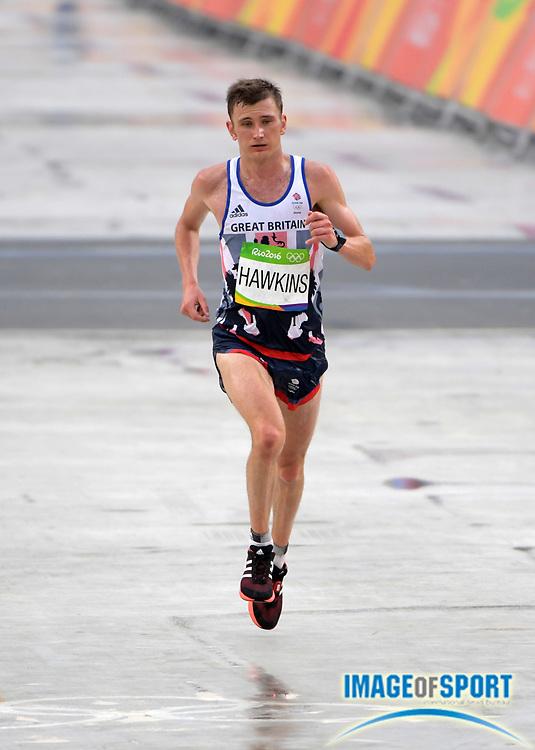 Aug 21, 2016; Rio de Janeiro, Brazil; Derek Hawkins (GBR) places 114th in 2:29:24 in the marathon during the Rio 2016 Summer Olympic Games at Sambodromo.