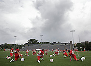 Marist football players stretch after returning to the field after stopping practice because thunder on Friday, Aug. 9, 2013, in Poughkeepsie.