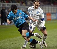 Fotball<br /> UEFA-cup<br /> Auxerre v PSV Eindhoven<br /> 11. mars 2004<br /> Foto: Digitalsport<br /> Norway Only<br /> <br /> YANN LACHUER (AUX) / YOUNG PYO LEE (PSV)<br /> <br /> <br />  *** Local Caption *** 40001078