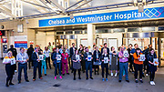 Hospital staff come out of Chelsea and Westminster and are greeted by a small but enthusiastic crowd, including several car loads of Met Police Officers - Clap for carers, to say thanks to NHS and other key workers and carers. The 'lockdown' continues in Clapham - Coronavirus (Covid 19) outbreak in London.