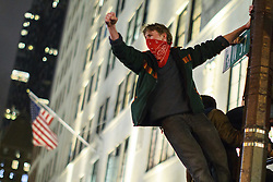 November 9, 2016 - New York, US, UK - New York, USA. Protesters climb a traffic light post as thousands of anti-Trump demonstrators protest outside Trump Tower after marching from Union Square in New York City, on Wednesday, 9 November 2016 following the presidential election won by Donald Trump. (Credit Image: © Tolga Akmen/London News Pictures via ZUMA Wire)