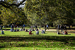 October 9, 2018 - London, London, United Kingdom - UK Weather - Warm and Sunny Autumn's Day in London. ..People enjoy an autumnal sunshine in St James Park on a warm October day as the temperature in the South East reaches 19 degrees celsius. October is likely to be the hottest month in 7 years as the Indian Summer returns in the capital. (Credit Image: © Dinendra Haria/i-Images via ZUMA Press)