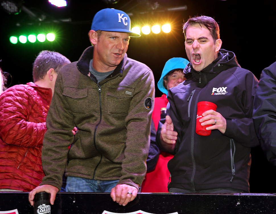 May 5, 2017; Talladega, AL, USA; NASCAR former driver Jeff Gordon and NASCAR Cup Series driver Clint Bowyer (14) reacts during a cheese eating contest during the Talladega Blvd Parade at Talladega Superspeedway. Mandatory Credit: Peter Casey-USA TODAY Sports