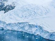 A tidewater glacier cracks crevasse patterns at Neko Harbor (Southern Ocean), Graham Land, the north portion of the Antarctic Peninsula, in Antarctica.