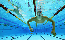 File photo dated 03-08-2012 of Swimmers warm up before the start of the competition at the Aquatics Centre, London.