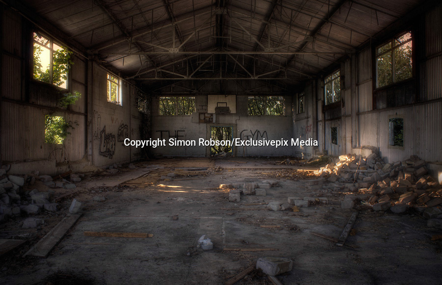 """Abandoned creepy pictures  of inside the former RAF Hospital<br /> <br /> Empty hallways and graffitied walls are some of the sights that have been photographed at the former Rauceby Hospital site.<br /> <br /> Photographer Simon Robson has been inside the former mental hospital which was also used as a place for burns victims during the Second World War.<br /> <br /> Mr Robson, who is from Lincoln, said he wanted to photograph the site because it was a former asylum. He said: """"I like the idea of going round a former asylum as it has more character about it.<br /> <br /> """"It was gutted on the inside, there were empty rooms and no furniture.<br /> He added an old hospital bed was something that he will remember from the site.<br /> <br /> """"When I went in the old chapel part there was an old hospital bed left in there which was quite creepy at the time.<br /> <br /> """"I don't think about where I am too much and stay in my own world of photography.""""<br /> <br /> The hospital originally opened in 1902 and the buildings included a chapel, two graveyards, a mortuary, and various tunnels connecting wards.<br /> The South Lincolnshire Community and Mental Health Services NHS Trust closed the main hospital building in 1997, but kept on Orchard House as the Trust's headquarters.<br /> <br /> Mr Robson added: """"I think it's places where people don't get to see inside that are fascinating - it's a fascination with the unknown.""""<br /> <br /> The 35-year-old from Lincoln said he was inspired to photograph places such as the former Rauceby Hospital site after seeing other photographs on online forums.<br /> <br /> He added that he always been interested in photography it was the subject of his degree, but admits it's more of a hobby for him now.<br /> ©Simon Robson/Exclusivepix Media"""
