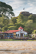 View of the exterior of houses on the waterfront of the town of El Castillo, Rio San Juan Department, Nicaragua