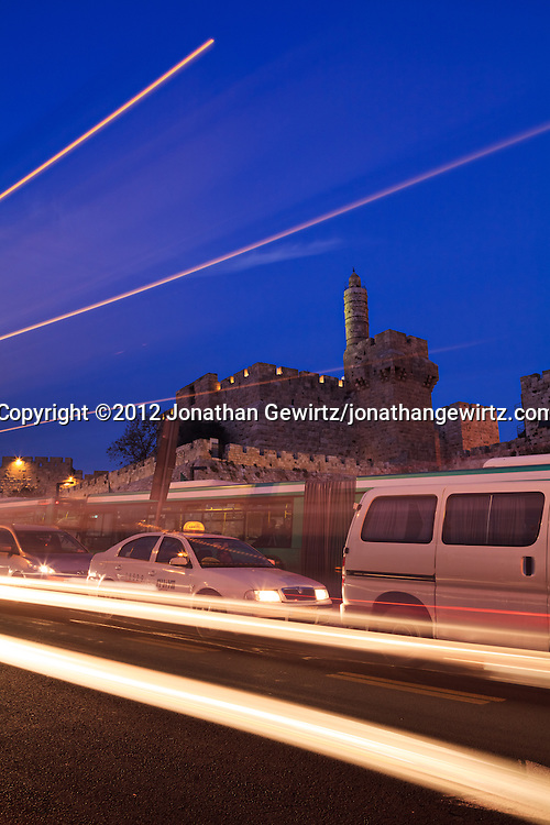 Rush-hour traffic on Jerusalem's Jaffa Street passes the Jaffa Gate and Citadel of David along the Old City's walls. WATERMARKS WILL NOT APPEAR ON PRINTS OR LICENSED IMAGES.