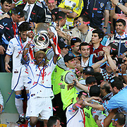 Jubilant Trabzonspor players Rigobert SONG lifting up the cup at the ceremony during their after the Turkey Cup final match Trabzonspor between Fenerbahce at the GAP Arena Stadium at Urfa Turkey on wednesday, 05 May 2010. Photo by TURKPIX