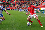 Charlton Athletic defender Ben Purrington (16) taking on Rochdale midfielder Jimmy Keohane (13) during the EFL Sky Bet League 1 match between Charlton Athletic and Rochdale at The Valley, London, England on 4 May 2019.