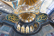 Detail of ornate dome calligraphic panel panes at Hagia Sophia, Ayasofya Muzesi, mosque museum in Istanbul, Turkey