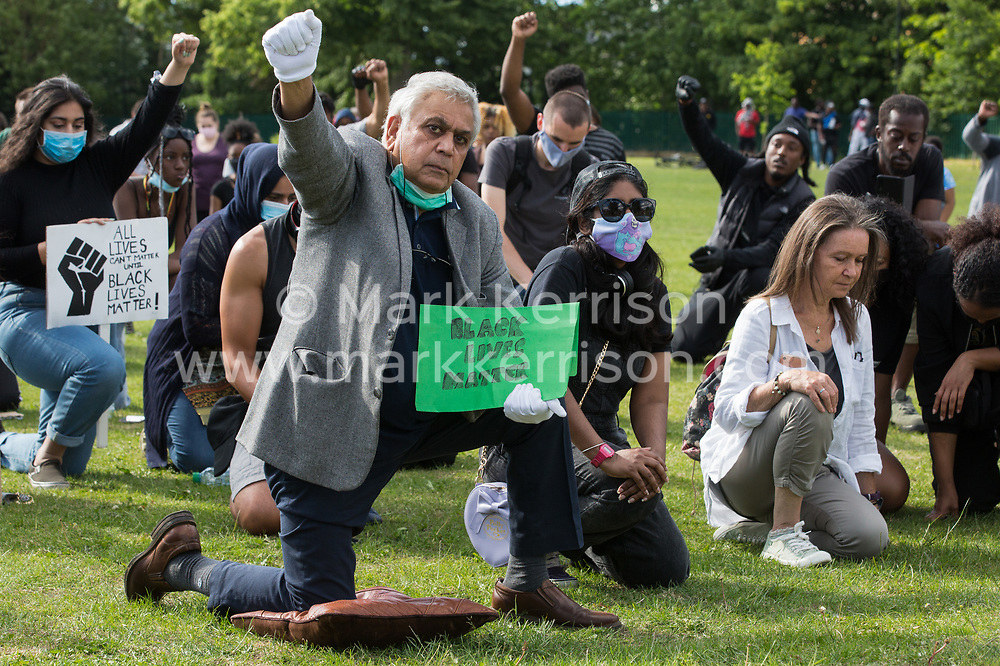 Local people take a knee during a peaceful protest in solidarity with the Black Lives Matter movement on 13th June 2020 in Salt Hill Park in Slough, United Kingdom. Protests in solidarity with the Black Lives Matter movement have taken place across the United States and in many countries around the world.