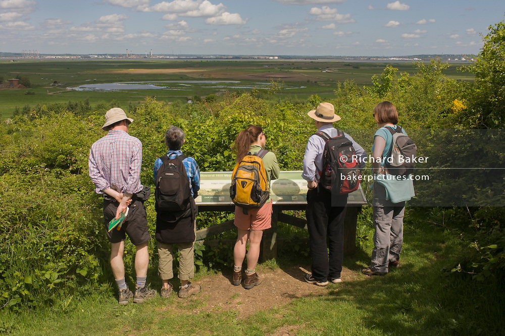 A group of country ramblers look across Northwood Hill's landscape below, an wildlife area near Halstow on the Kent Thames estuary marshes, potentially threatened by the future London airport.