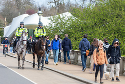 """© Licensed to London News Pictures. 02/04/2021. London, UK. Mounted Police patrol Hyde Park, London enforcing the """"Rule of Six"""" as members of the public go out on the first bank holiday of the Easter weekend as Prime Minister Boris Johnson urges the public not to break the remaining Covid-19 restrictions. Photo credit: Alex Lentati/LNP"""