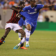 Mikel, Chelsea, is held by Kingsley Boateng, AC Milan,  during the Chelsea V AC Milan Guinness International Champions Cup tie at MetLife Stadium, East Rutherford, New Jersey, USA.  4th August 2013. Photo Tim Clayton