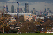 With the capital rising in the background, a cyclist rides through Brockwell Park in Herne Hill, Lambeth SE24 south London.