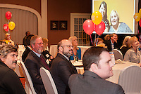 """Jack Terrill sitting with Kevin Conway watch a video filled with """"well wishes"""" from their United Way employees during a reception held Tuesday evening at Church Landing.   (Karen Bobotas/for the Laconia Daily Sun)"""