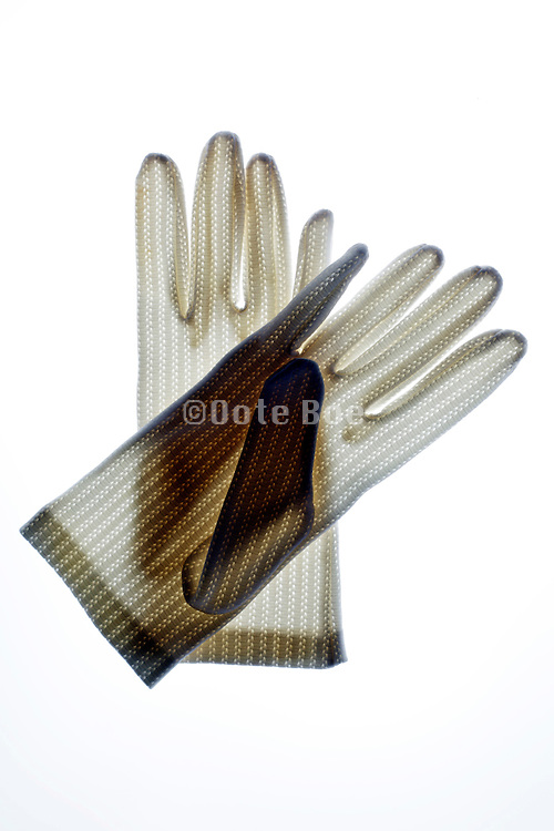 two white gloves laying on top of each other
