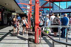 People queueing in Basildon Bus Station. Essex