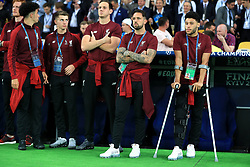 Liverpool's Alex Oxlade-Chamberlain (right) on crutches due to a knee injury during the UEFA Champions League Final at the NSK Olimpiyskiy Stadium, Kiev.