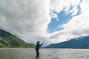 David Page spey casts for June chinook salmon at the river mouth of BC's Dean River.