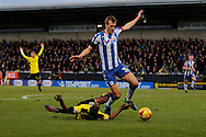 Burton Albion striker Marvin Sordell (9) tussles with Wigan Athletic defender Dan Burn (33) during the EFL Sky Bet Championship match between Burton Albion and Wigan Athletic at the Pirelli Stadium, Burton upon Trent, England on 14 January 2017. Photo by Richard Holmes.