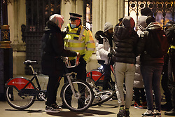 © Licensed to London News Pictures. 31/12/2020. London, UK. Police talk to a group of youths who were cycling around Parliament Square ahead of midnight and a muted New Year's Eve in central London. Photo credit: Peter Macdiarmid/LNP