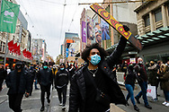 Masked protesters holding placards march through the CBD during a Black Lives Mater rally on 06 June, 2020 in Melbourne, Australia. This event was organised to rally against aboriginal deaths in custody in Australia as well as in unity with protests across the United States following the killing of an unarmed black man George Floyd at the hands of a police officer in Minneapolis, Minnesota. (Photo by Dave Hewison/ Speed Media)
