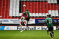 Charlton's Chuks Aneke is crowded out in the air during the EFL Sky Bet League 1 match between Charlton Athletic and Rochdale at The Valley, London, England on 12 January 2021.