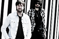 Paris, France - February 9, 2012: Portrait of the british rock group Kasabian with Tom Meighan and Sergio Pizzorno at Paris, France on february 9th, 2012