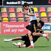 Galatasaray's players Milan BAROS (F), Gokhan ZAN (B) during their training session at the Jupp Derwall training center, Tuesday, April 20, 2010. Photo by TURKPIX