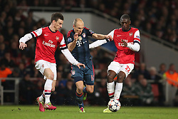 19.02.2014, Emirates Stadion, London, ENG, UEFA CL, FC Arsenal vs FC Bayern Muenchen, Achtelfinale, im Bild Arjen Robben (FC Bayern Muenchen #10) im Zweikampf gegen / tackling against Laurent Koscielny (Arsenal FC #6), Yaya Sanogo (Arsenal FC #22 - rechts), Aktion, Action // during the UEFA Champions League Round of 16 match between FC Arsenal and FC Bayern Munich at the Emirates Stadion in London, Great Britain on 2014/02/19. EXPA Pictures © 2014, PhotoCredit: EXPA/ Eibner-Pressefoto/ Schueler<br /> <br /> *****ATTENTION - OUT of GER*****
