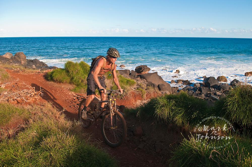 Mountain biking along the Kauai shoreline, Hawaii ****Model Release available