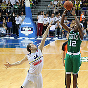 Fenerbahce Ulker's Bojan Bogdanovic and Boston Celtics's Dionte Christmas (R) during their NBA Europe Live 2012 The four-game tour tips match Fenerbahce Ulker between Boston Celtics at Fenerbahce Ulker Sports Arena in Istanbul, Turkey, Friday, October 05, 2012. Photo by TURKPIX