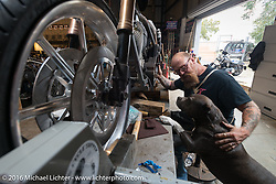 """Bill Dodge works with his good buddy """"Buddy"""" on the primary drive of Jim Root's (from the band Slipknot) custom Harley-Davidson FXR in his Blings Cycle shop during Daytona Bike Week 75th Anniversary event. FL, USA. Friday March 4, 2016.  Photography ©2016 Michael Lichter."""