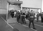 Body of Private Stephen Griffin killed in Lebanon is returned to his home soil..1980-04-19.19th April 1980.19-04-1980.04-19-80..Photographed at Dublin Airport Mortuary..Comrades of Private Stephen Griffin carry his coffin from the mortuary chapel. The pallbearing party is from the 2nd Garrison Military Police. The coffin is draped in the Irish and United Nations flags. ..Behind the cortege is The dead Private's aunt, Kathleen and brother  Michael.