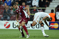 Ricardo Cadu (L) of CFR Cluj challenges Javier Hernandez (R) of Manchester United during the UEFA Champions League, Group H, soccer match at Dr. Constantin Radulescu Stadium in Cluj-Napoca, Romania, 2 October 2012.