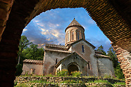 """Pictures & imagse of Timotesubani medieval Orthodox monastery Church of the Holy Dormition (Assumption), dedcated to the Virgin Mary, 1184-1213, Samtskhe-Javakheti region, Georgia (country).<br /> <br /> Built during the reigh of Queen Tamar during the """"Golden Age of Georgia"""", Timotesubani Church of the Holy Dormition is one of the most important examples of medieval Georgian architecture and art. <br /> <br /> Built of pinkish Georgian brick to a cruciform floor plan. The eastern end of the church has 3 apses. Above the centre of the church is a high Georgian style cupola supported on 2 columns.<br /> <br /> .Visit our MEDIEVAL PHOTO COLLECTIONS for more   photos  to download or buy as prints https://funkystock.photoshelter.com/gallery-collection/Medieval-Middle-Ages-Historic-Places-Arcaeological-Sites-Pictures-Images-of/C0000B5ZA54_WD0s<br /> <br /> Visit our REPUBLIC of GEORGIA HISTORIC PLACES PHOTO COLLECTIONS for more photos to browse, download or buy as wall art prints https://funkystock.photoshelter.com/gallery-collection/Pictures-Images-of-Georgia-Country-Historic-Landmark-Places-Museum-Antiquities/C0000c1oD9eVkh9c"""
