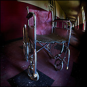 Red wheelchair in a red corridor