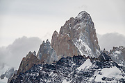"""From Mirador Loma del Pliegue Tumbado, see Cerro Fitz Roy (3405 m or 11,171 ft elevation). From El Chalten, we hiked to Mirador """"Loma del Pliegue Tumbado"""" (""""hill of the collapsed fold""""), 19 km (11.9 mi) with 1170 meters (3860 ft) cumulative gain in Los Glaciares National Park, in Argentina, Patagonia, South America. El Chalten mountain resort is 220 km north of El Calafate. Chaltén comes from a Tehuelche word meaning """"smoking mountain"""", due to clouds that usually form over Monte Fitz Roy. El Chalten mountain resort is in Santa Cruz Province, Argentina, Patagonia, South America."""