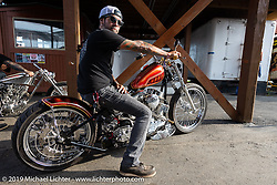 Custom bike builder at Providence Cycle Worx (and former drummer of Buckcherry) Xavier Muriel with Grace, his Pan Shovel at the Rats Hole annual custom bike show in the Crossroads area of the Buffalo Chip during the Sturgis Black Hills Motorcycle Rally. SD, USA. Thursday, August 8, 2019. Photography ©2019 Michael Lichter.