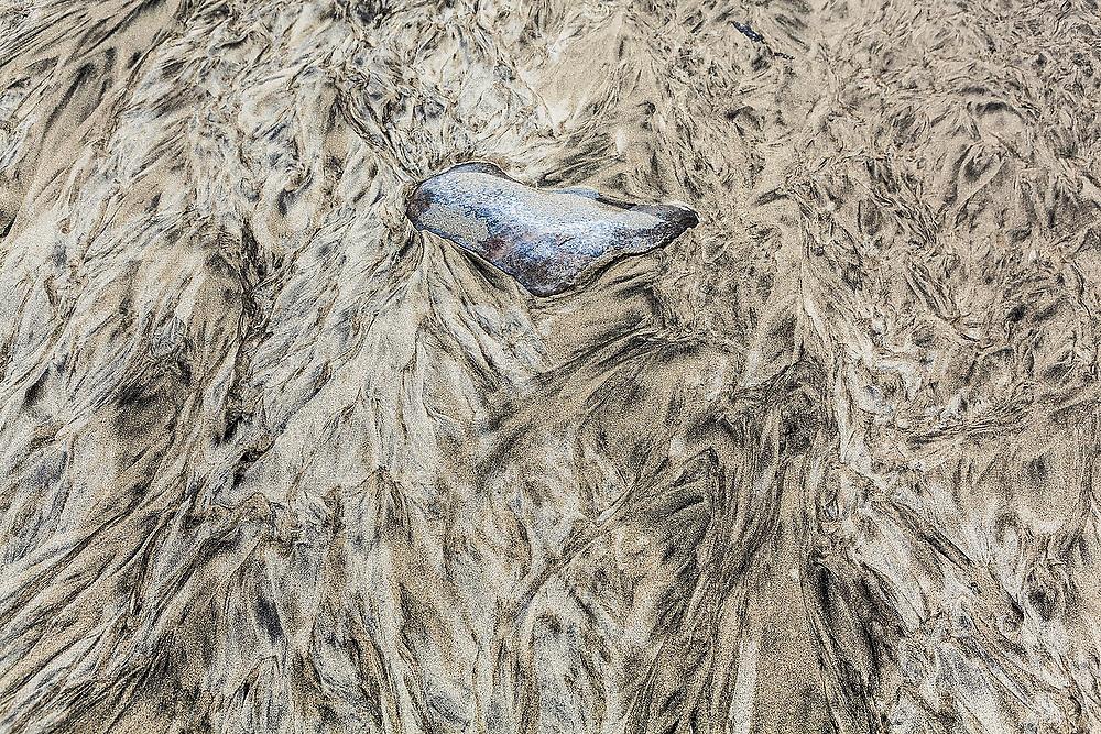 Ripple patterns caused by sediment transport by water in the sand on Bunes Beach, Moskenesoya, Lofoten Islands, Norway.