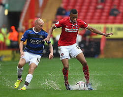 Charlton Athletic's Jordan Cousins tussles for the ball with Doncaster Rovers' David Cotterill  - Photo mandatory by-line: Robin White/JMP - Tel: Mobile: 07966 386802 24/08/2013 - SPORT - FOOTBALL - The Valley - Charlton -  Charlton Athletic V Doncaster Rovers - Sky Bet League Two