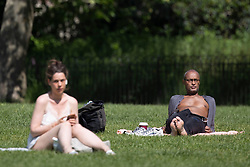 © Licensed to London News Pictures. 02/06/2021. London, UK. Members of the public relax and enjoy the sunny weather in Green Park in Central London. Temperatures are expected to rise with highs of 28 degrees forecasted for parts of London and South East England today . Photo credit: George Cracknell Wright/LNP
