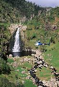 Helicopter in front of Waterfall, Waimea Canyon, .Kauai, Hawaii, tour, aerial