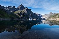 Trolltindan mountain peaks reflect in Trollfjordvatnet lake, Trollfjord, Austvågøy, Lofoten Islands, Norway