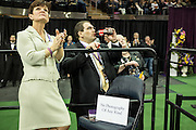 """New York, NY - 16 February 2016. Westminster Kennel Club officials during the Junior Division competition at the 140th Westminster Kennel Club Dog show in Madison Square Garden. The sign on the chair reads """"No Photography of Any Kind"""". and prohbits photography from the press risers of dogs waiting to enter the ring."""