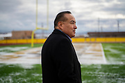Quincy Natay, Superintendent of Chinle Unified School District stands for a portrait at the football field. The faculty was recently renovated, but no students have been able to benefit from the update do to the COVID-19 pandemic.