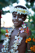 Child wearing ceremonial decorations and flowers, Tufi, Cape Nelson, Oro Province, Papua New Guinea