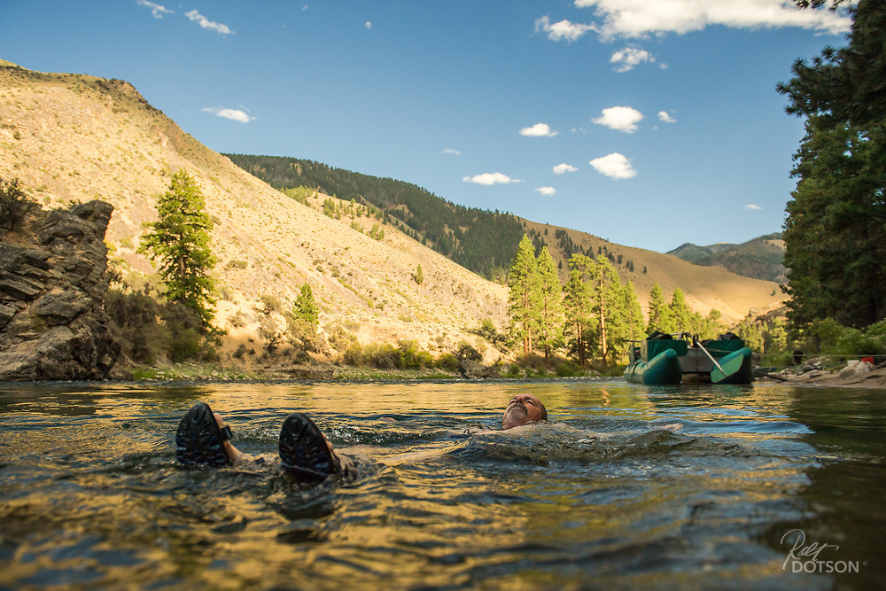 Taking his evening laps doing relaxing back strokes, Tom Hansen is able to take in the magnificant canyon walls and fading light of the lower Middle Fork of the Salmon River.